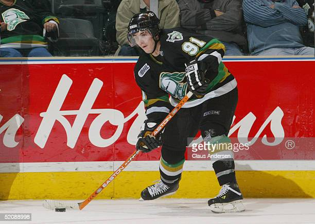 David Bolland of the London Knights looks to make a pass play from the wing during the Ontario Hockey League game against the Erie Otters at John...