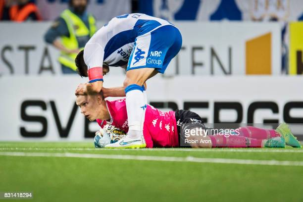 David Boo Wiklander thanks Pontus Dahlberg goalkeeper of IFK Goteborg for saving a chance during the Allsvenskan match between IF Elfsborg and IFK...