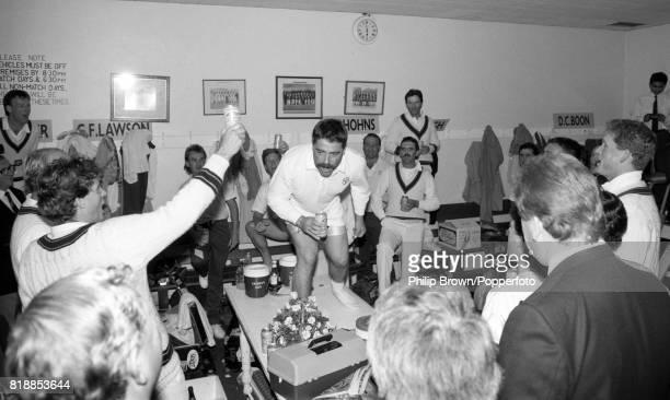 David Boon of Australia leads the team in a rendition of the team song 'Under the Southern Cross' at the end of the 6th Test match between England...