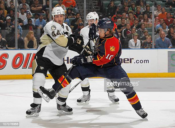 David Booth of the Florida Panthers and Brooks Orpik of the Pittsburgh Penguins fight in front of the Penguin net in the first period on November 22...