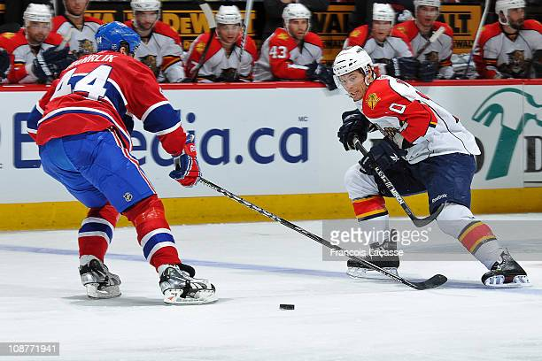 David Booth of the Florida Panthers attempts to skate past defenceman Roman Hamrlik of the Montreal Canadiens during the NHL game on February 2, 2011...