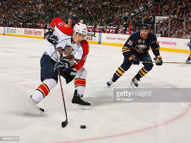 David Booth of the Florida Panthers controls the puck against Henrik Tallinder of the Buffalo Sabres on March 12, 2009 at HSBC Arena in Buffalo, New...