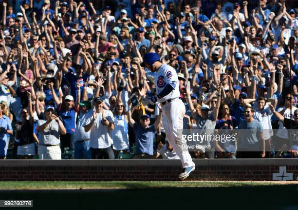 David Bote of the Chicago Cubs celebrates after his gamewinning walk during the tenth inning on July 8 2018 at Wrigley Field in Chicago Illinois The...