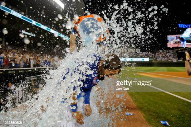 David Bote of the Chicago Cubs is dunked in gatorade by Kyle Schwarber after his walkoff grand slam against the Washington Nationals at Wrigley Field...