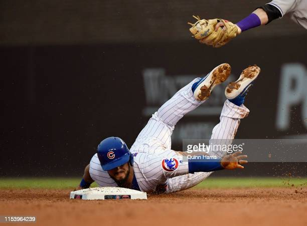 David Bote of the Chicago Cubs is tagged out in the third inning trying to steal second base against the Colorado Rockies at Wrigley Field on June 05...
