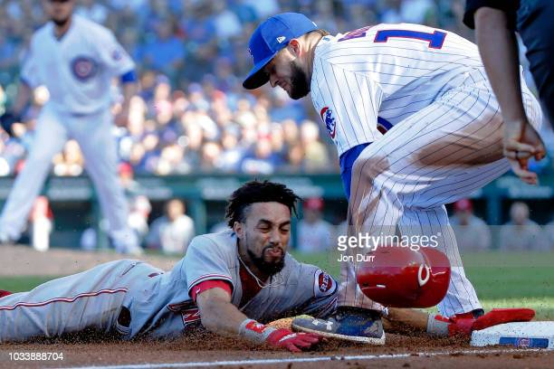 David Bote of the Chicago Cubs tags out Billy Hamilton of the Cincinnati Reds as he attempts to steal third base during the sixth inning at Wrigley...