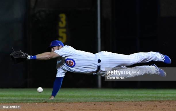David Bote of the Chicago Cubs tries to make a catch on a single hit by Kevin Newman of the Pittsburgh Pirates during the ninth inning on September...