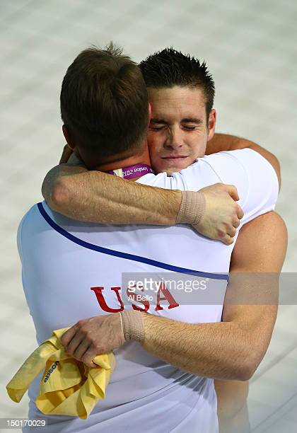 David Boudia of the United States celebrates with his coach Adam Soldati after winning the Men's 10m Platform Diving Final on Day 15 of the London...
