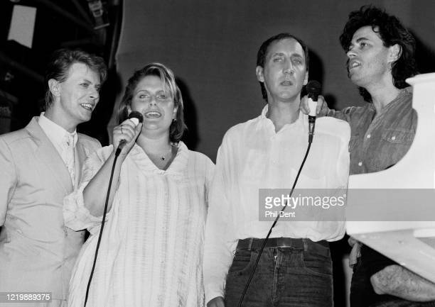 David Bowie Alison Moyet Pete Townshend and Bob Geldof perform on stage singing 'Do They Know It's Christmas' during the finale of the Live Aid...