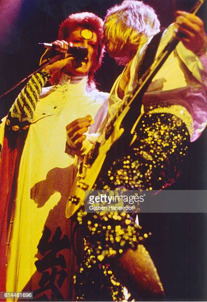 David Bowie and guitarist Mick Ronson perform on stage on the Ziggy Stardust tour Earls Court Arena London 12th May 1973