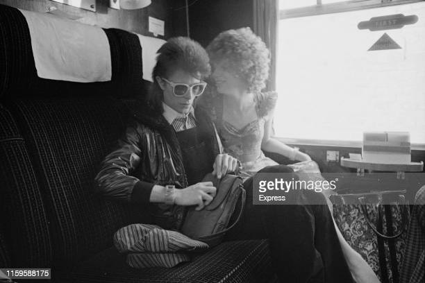 David Bowie and his wife Angie at Victoria Station London 9th July 1973 David is on his way to France to record his covers album 'Pinups' at the...