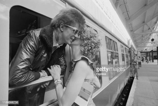 David Bowie and his wife Angie at Victoria Station, London, 9th July 1973. David is on his way to France to record his covers album, 'Pinups' at the...