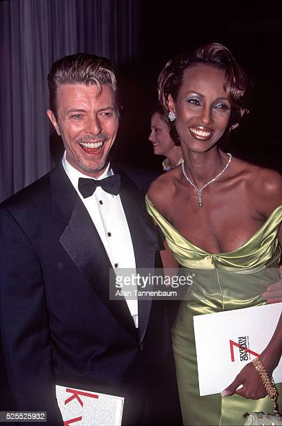David Bowie and his wife Iman arrive at the '7th on Sale' fashion shopping and dinner Benefit for AIDS New York New York May 17 1995