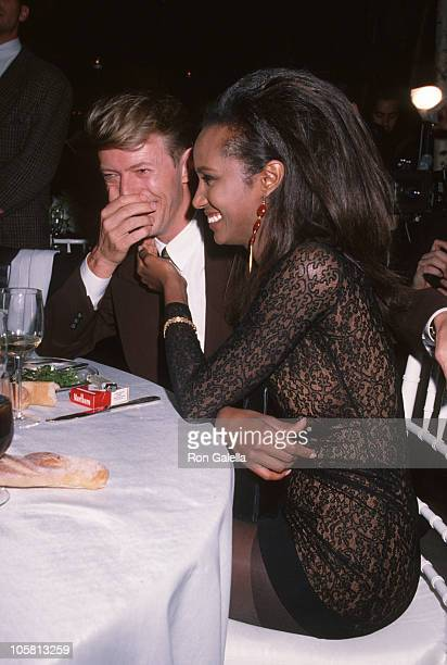 David Bowie and Iman during '7th On Sale' To Benefit AIDS Research November 29 1990 at 69th Regiment Armory in New York City New York United States