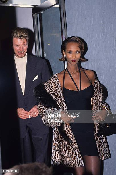 David Bowie and Iman during Cork Street Art Exhibition of David Bowie's Work at Cork Street in London United Kingdom