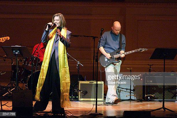 David Bowie and Moby on stage performing during the Tibet House Benefit Concert 2001 with artistic director Philip Glass Dana Bryant Emmylou Harris...