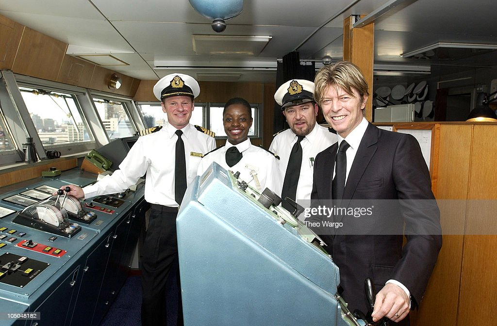 David Bowie and QE2 crew members during David Bowie disembarks the QE2 in New York City from England. David Bowie will begin his North American tour on the Area2 Music Festival at New York Pier 62 in New York City, New York, United States.