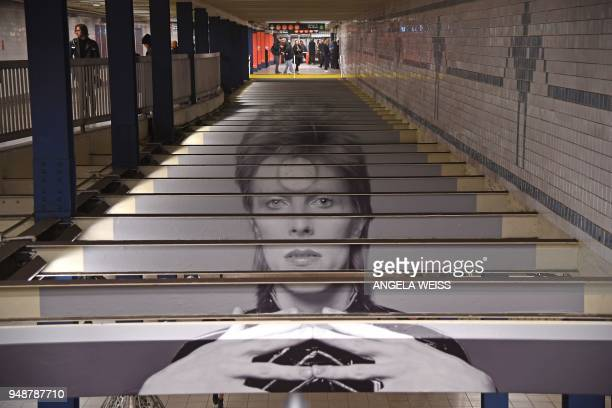 David Bowie art installation is seen at the BroadwayLafayette subway station on April 19 2018 in New York City The subwaywallsized images of...