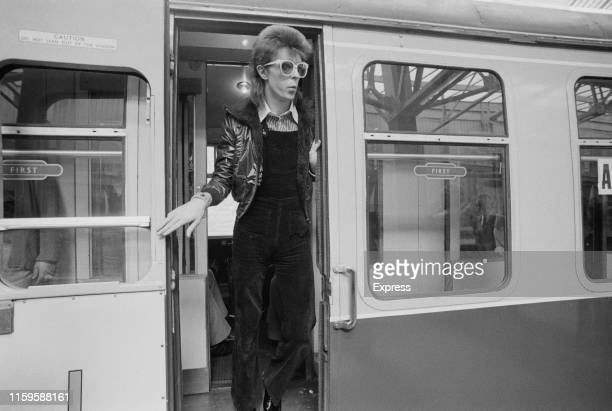 David Bowie at Victoria Station, London, 9th July 1973. He is on his way to France to record his covers album, 'Pinups' at the Château d'Hérouville.