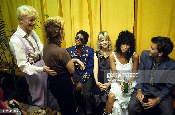David Bowie backstage during his 'Serious Moonlight' tour with actress Bette Midler Michael Jackson and Cher 1983