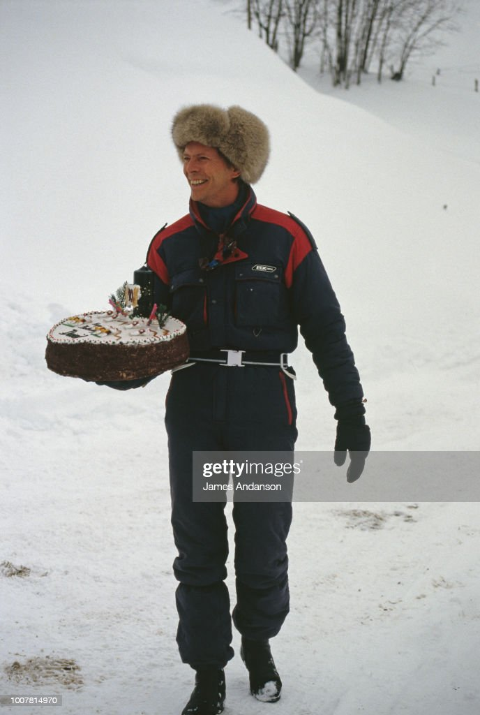 David Bowie holding his 40th birhday cake, Gstaad,