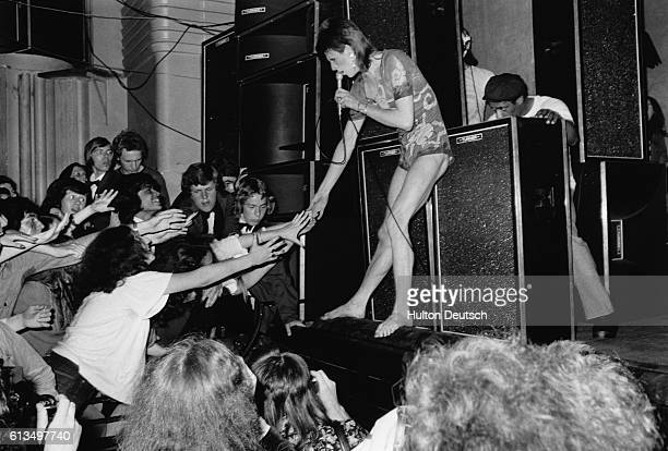 David Bowie in concert as his alter ego Ziggy Stardust at the Hammersmith Odeon