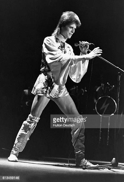 David Bowie in concert at the Hammersmith Odeon in London on the last night of his Ziggy Stardust UK tour.