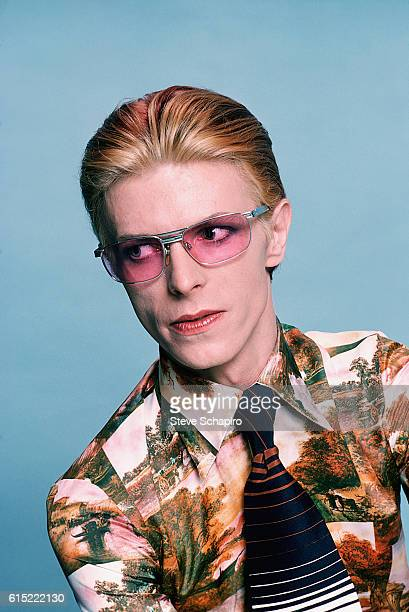 David Bowie in pink sunglasses