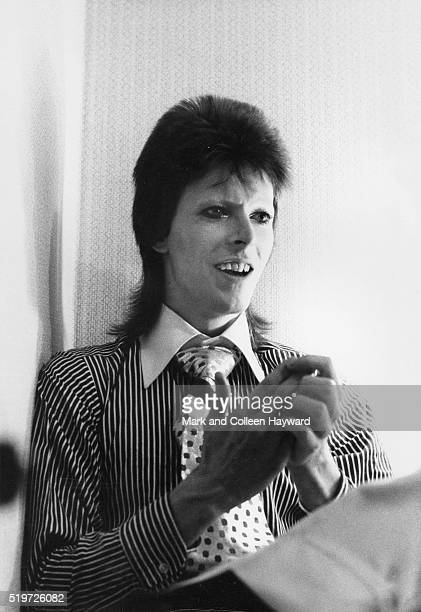 David Bowie in Ziggy Stardust era wearing striped shirt and broad patterned tie 1973