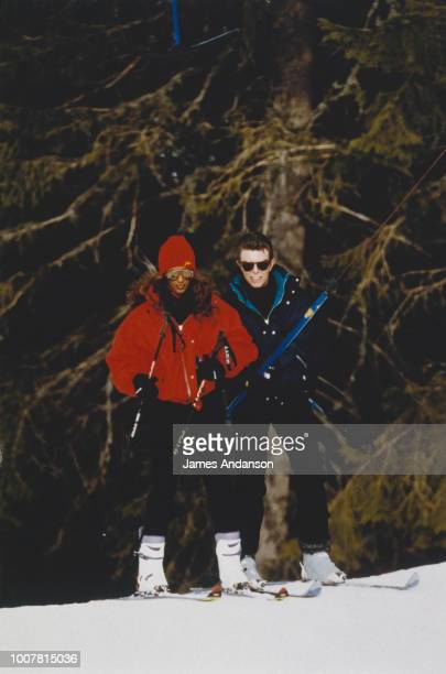 David Bowie is providing ski lessons to his wife Iman Bowie Gstaad 4th January 1993