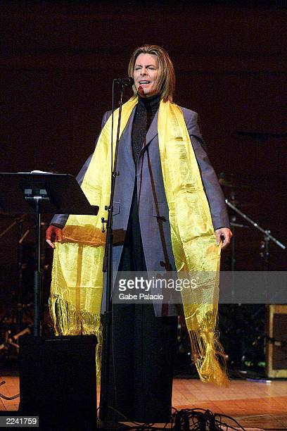 David Bowie on stage performing during the Tibet House Benefit Concert 2001 with artistic director Philip Glass Dana Bryant Emmylou Harris Patti...