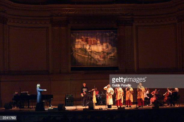 David Bowie on stage performing with Philip Glass on pieano and monks duing the Tibet House Benefit Concert 2001 with artistic director Philip Glass...
