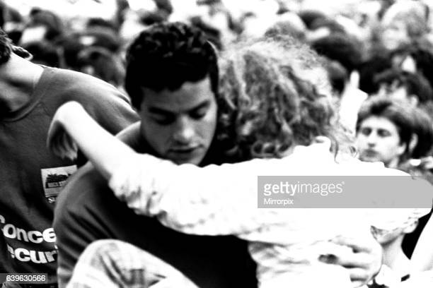 David Bowie performing at Roker Park, Sunderland on 23rd June 1987 in his Glass Spider Tour A girl who has fainted being brought to the front.