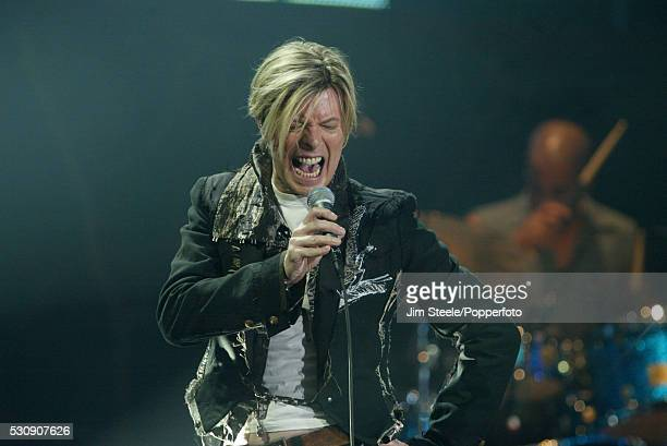 David Bowie performing on stage at Wembley Arena in London on the 26th November, 2003.