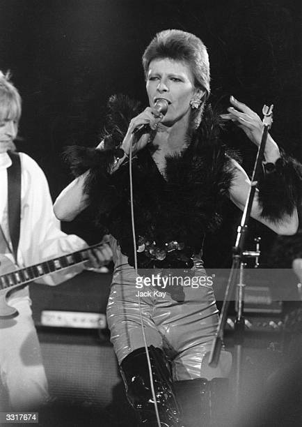 David Bowie performing with guitarist Mick Ronson at a live recording of 'The 1980 Floor Show' for the NBC 'Midnight Special' TV show at The Marquee...
