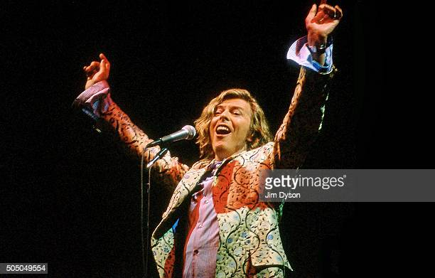 David Bowie performs live on the Pyramid stage wearing a coat designed by Alexander McQueen at the Glastonbury festival at Worthy Farm on June 25...