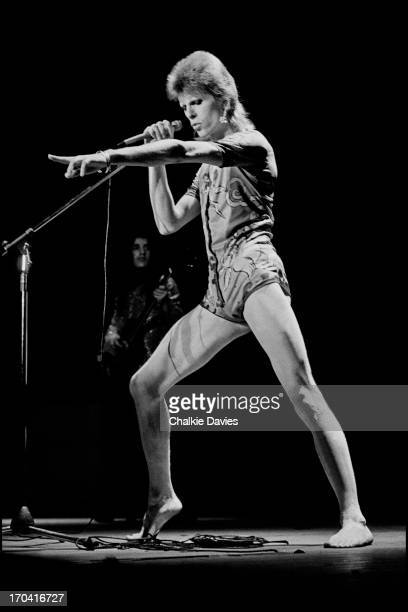 David Bowie performs on stage at Hammersmith Odeon on the last night of the Ziggy Stardust Tour, London, 3rd July 1973. At the end of the show David...