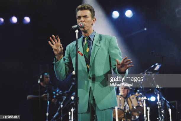 David Bowie performs on stage at the Freddie Mercury Tribute Concert for AIDS Awareness Wembley Stadium London 20th April 1992 Queen drummer Roger...