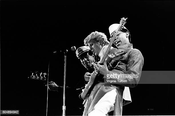 David Bowie performs on stage on the 'Serious Moonlight' tour Wembley Stadium United Kingdom 4th June 1983 LR Carmine Rojas David Bowie and Carlos...