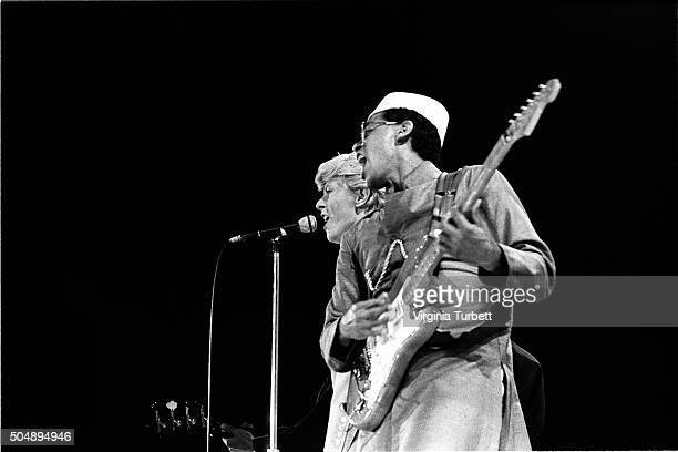 David Bowie performs on stage on the 'Serious Moonlight' tour Wembley Stadium United Kingdom 4th June 1983 LR David Bowie and Carlos Alomar