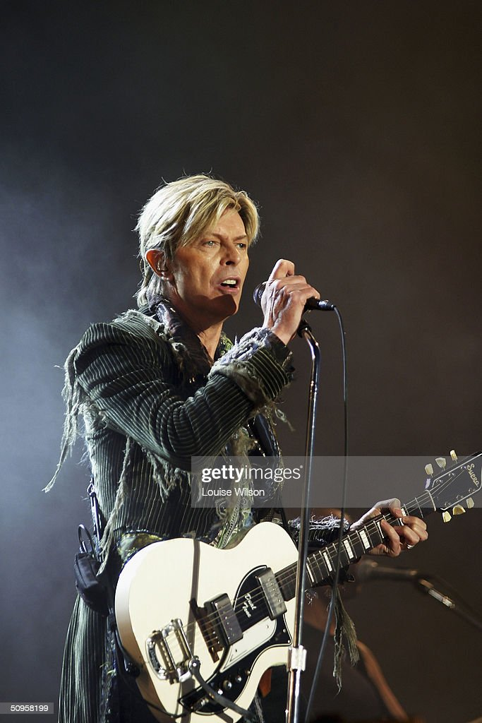 David Bowie performs on stage on the third and final day of 'The Nokia Isle of Wight Festival 2004' at Seaclose Park, on June 13, 2004 in Newport, UK. The third annual rock festival takes place during the Isle of Wight Festival which runs from June 4-19.