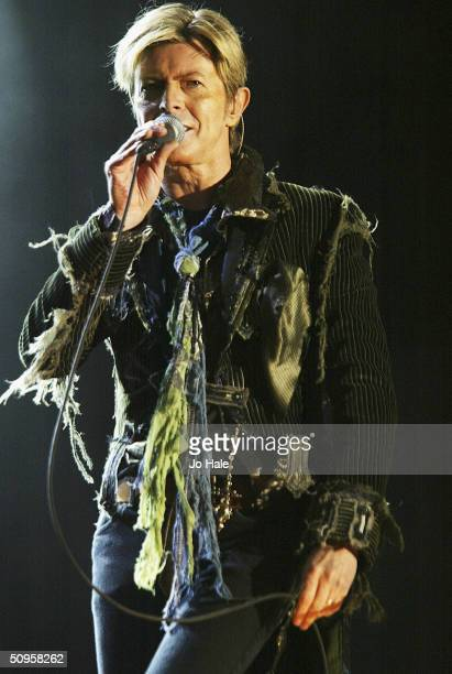 "David Bowie performs on stage on the third and final day of ""The Nokia Isle of Wight Festival 2004"" at Seaclose Park, on June 13, 2004 in Newport,..."