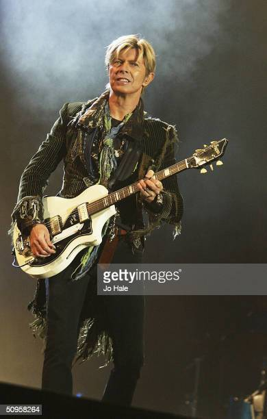 David Bowie performs on stage on the third and final day of The Nokia Isle of Wight Festival 2004 at Seaclose Park on June 13 2004 in Newport UK The...