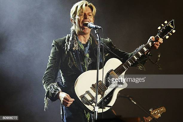 David Bowie performs on stage on the third and final day of 'The Nokia Isle of Wight Festival 2004' at Seaclose Park on June 13 2004 in Newport UK...