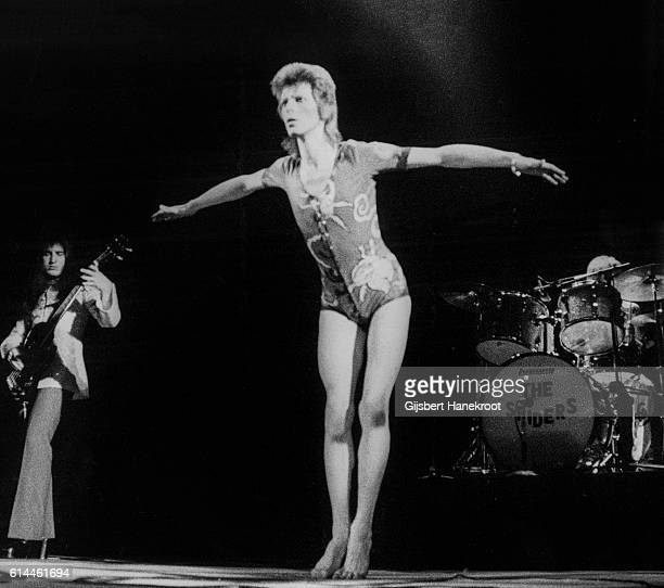 David Bowie performs on stage with Trevor Bolder and Mick Woody Woodmansey on the Ziggy Stardust tour Earls Court Arena London 12th May 1973