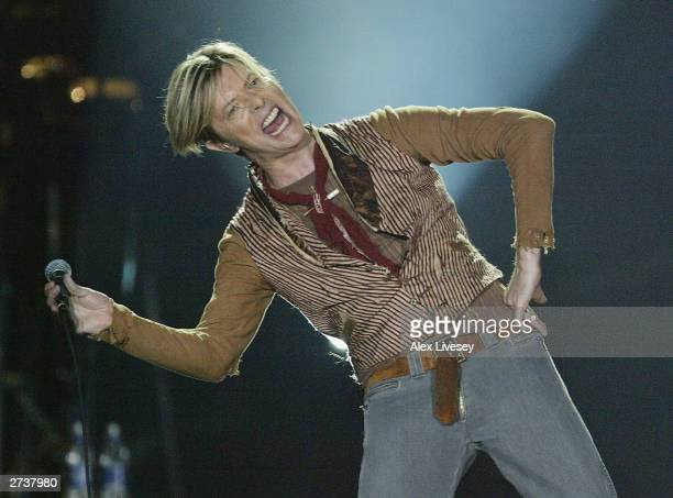David Bowie performs on the first night of his UK tour at the MEN Arena on November 17, 2003 in Manchester, England.