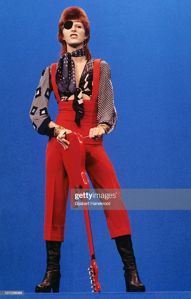 David Bowie (wearing an eyepatch) performs 'Rebel Rebel' on the TV show TopPop on 7th February 1974 in Hilversum, Netherlands.