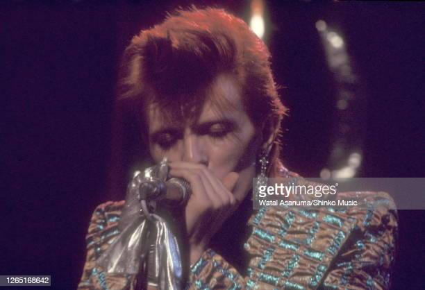 David Bowie performs 'The Jean Genie' on BBC TV show 'Top Of The Pops' London on 3rd January 1973 Mick Woodmansey David Bowie Mick Ronson The...