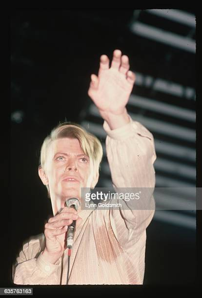 1978 David Bowie points the heavens as he performs on stage