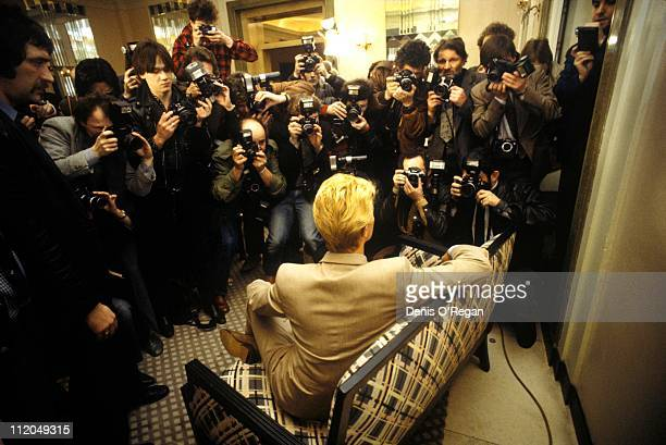 David Bowie poses for photographers at a press conference in London 1983
